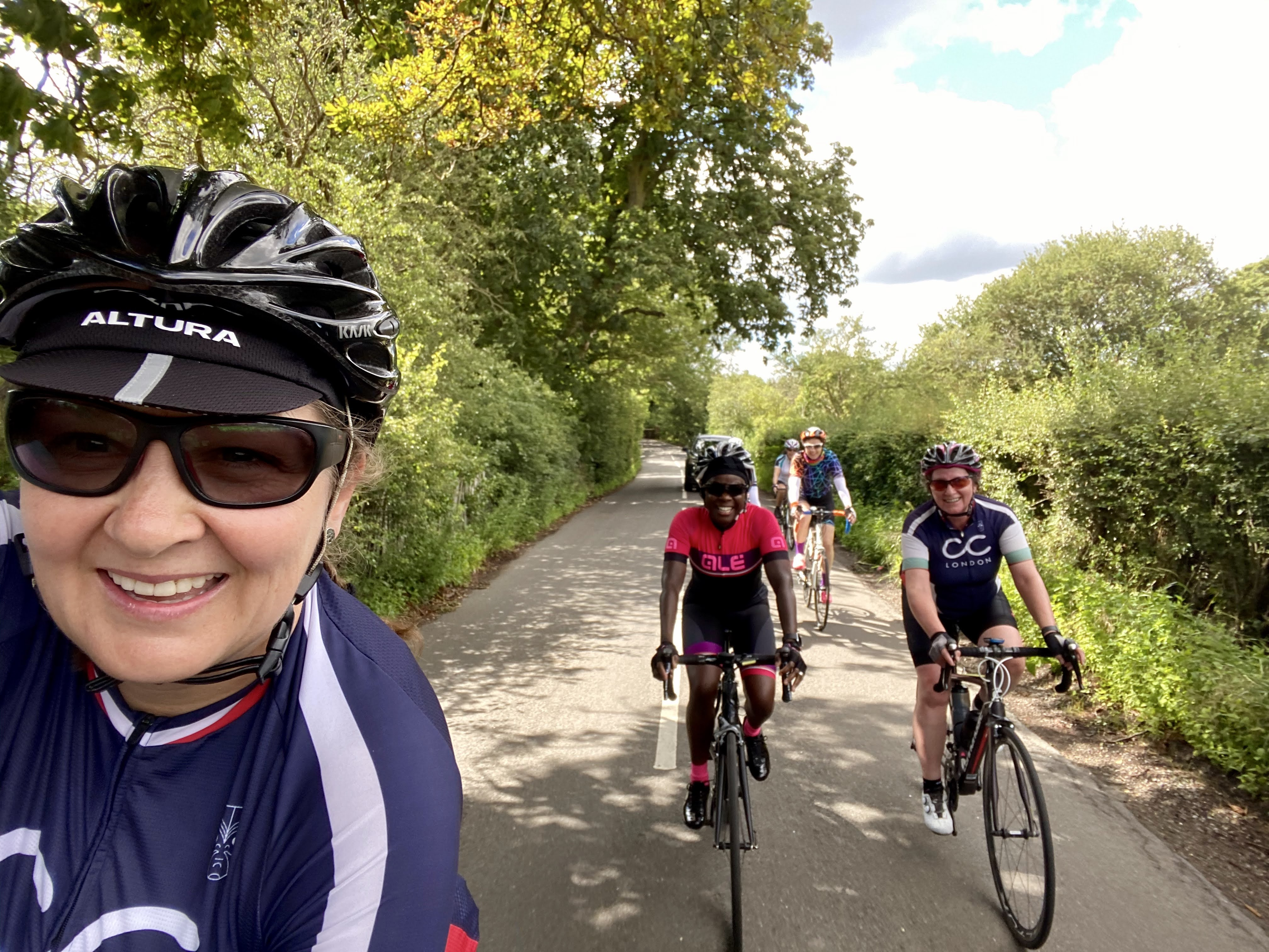 A group of women riding their bikes on a road as part of a cycling club ride